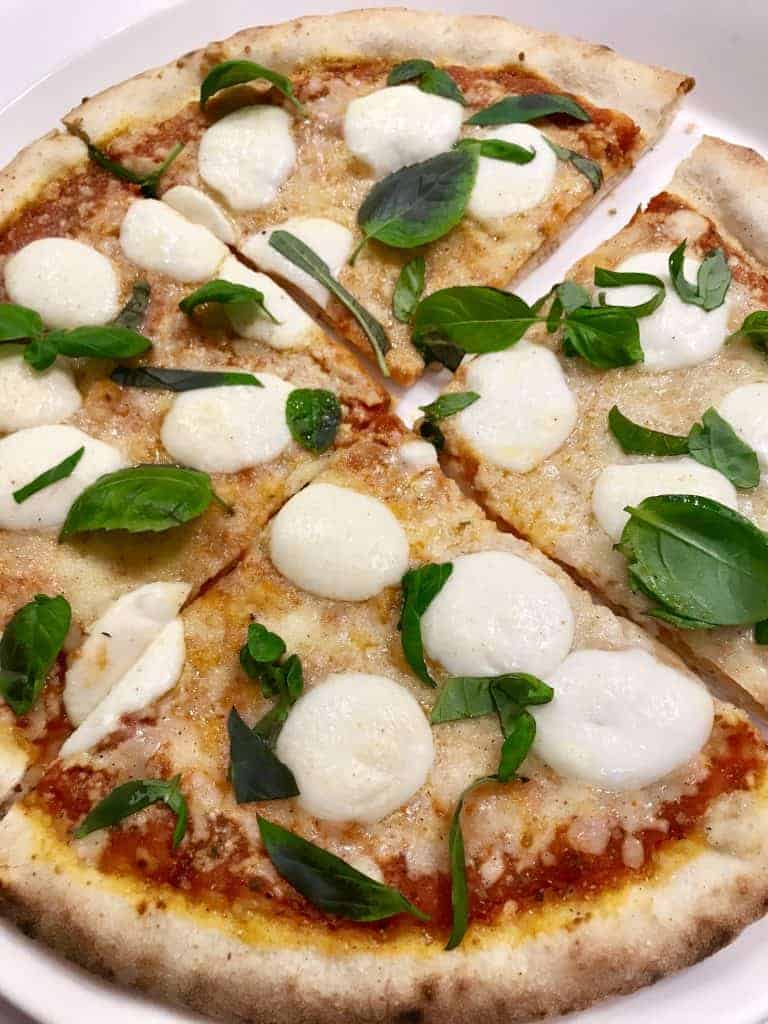 make pizza at home, rather than restaurant delivery