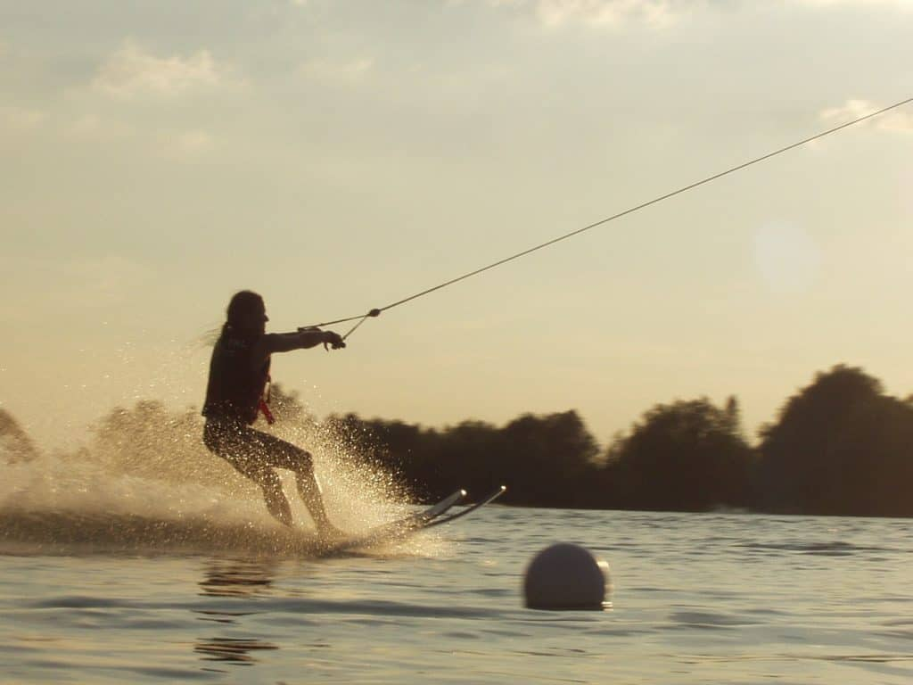 water skiing, somewhat similar using a wakeboard